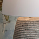 Close up Weather Beaten Stone Ceramic Table Lamp with white shade.